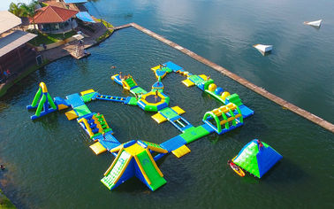 China 0.9mm PVC Tarpaulin Adults  Inflatable Floating Water Park Games With TUV Certification supplier