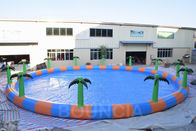 China Commercial 15m Diameter Round Inflatable Water Swimming Pools With Palm Tree factory