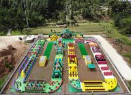 China 0.9mm PVC Tarpaulin Giant Inflatable Obstacle Course 63.5m L *25m W factory